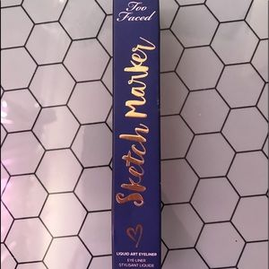 Too faced sketch marker. Shade deep navy blue.